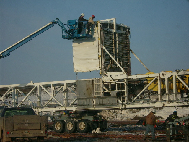 Installing tarp on a oil rig